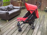Red OBaby fully reclining childs pushchair