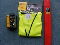 AA Car winter essentials: Universal bulb and fuse kit, high vis vest, emergency triangle.