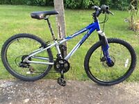 "Boys/Girls Apollo XC.24* Mountain Bike; 12"" Blue & Silver frame; 21-speed twist-grip shimano gears"