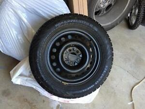 Snow tires with rims off of 2011 Toyota Sienna