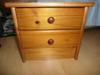 Two solid wood bedside cabinets, vg condition.