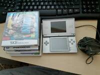 DS Lite Silver with charger and 4games