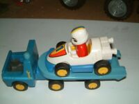 Breakdown lorry and trailer with racing car and figure, good used condition