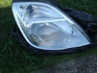 Ford fiesta 2003 on Right and left Headlamps good condition 2 new front an rear springs never fitted