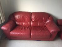 FREE: 2 red, leather sofas seeking new home. For collection only