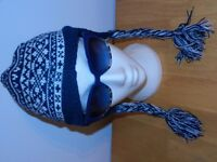 Knitted Chullos style hat with ear flaps
