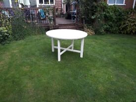 Ikea round wooden table in white with fittings. No chairs.