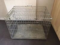 Metal dog crate suitable for spaniel size dog