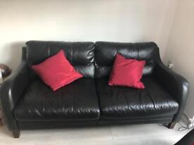 Black leather settee and footstoll