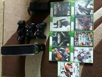 Xbox 360 slim 250gb, complete with 2 wireless controllers and venom charging dock, plus games