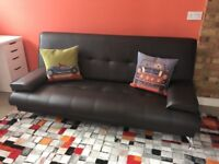 Brown sofa bed with mattress and cushions