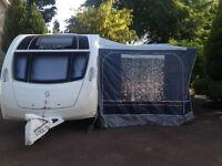 Dorema full caravan awning. Size 13, 950-975 cm. 25mm Steel poles. Blue. Very good condition.