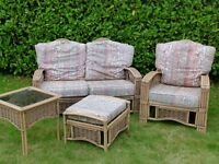 cane sofa, chits and footstool