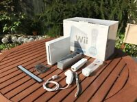 Nintendo Wii console with Controller. White. Includes Nintendo Wii Nunchuk