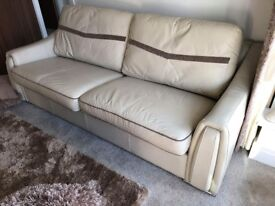 2 Almost new Cream leather and material reversible cushion sofas, 3 seater and a 2 seater