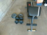 Weights bench with dumbbells and weights