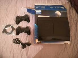 PlayStation 3 with two controllers