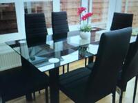 Glass table + 6 chairs £100