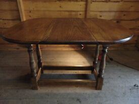 Solid oak drop leaf carved coffee table