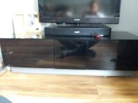 TV Unit. Black Glass with 2 doors and 1 draw. Excellent condition. L 125cm D 47cm H 37cm approx