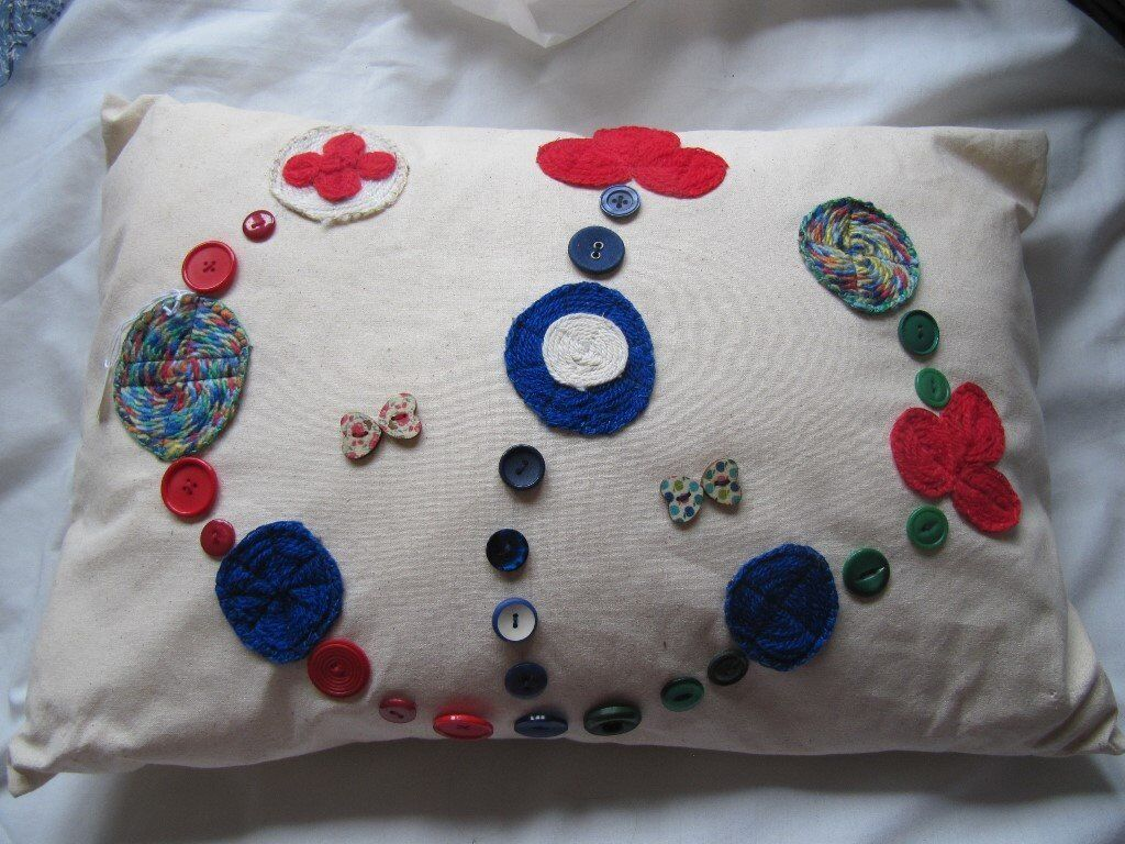 NEW Oblong new wool and button embellished calico cushion