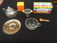 Tea set. Glass tea pot, cup and accessories.