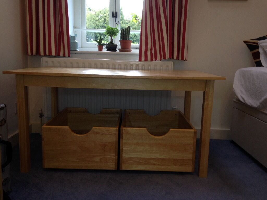 Child's desk or play table with short & long legs and 2 storage trundles - very versatile.