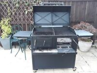 BBQ with double grills, ash tray for easy cleaning. side tables, lid for smoking food. Good quality