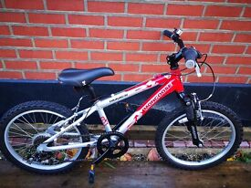 Ages 8+ Metallic Red and white Mongoose Rockadile bike with seven gears. Excellent condition