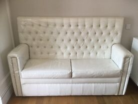 White chesterfield luxury Faux leather sofa/ booth seating with under seat storage!
