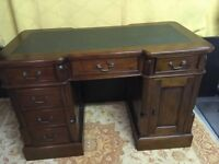 Mahogany reproduction desk with green leather desk insert