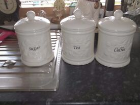 large ceramic tea, coffee and sugar canisters. cream