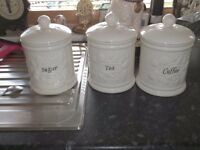 large ceramic tea, coffee and sugar canisters. cream