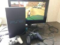 Sony PlayStation 2 console with 2 controllers and games