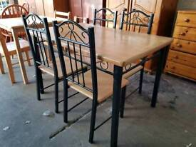 Modern wooden top dining table with 4 chairs