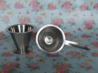 Vintage 'Rostfritt Stal' stainless steel tea strainer and stand