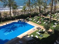 2 bedroom beach apartment Marbella, Spain. 3 communal outdoor pools set in gardens with sunloungers