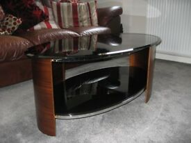 Coffee table by Jual Furniture. Real wood veneer. Black glass top and shelf. Near new condition.