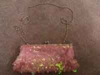 Pink iridescent shell sequinned clutch bag