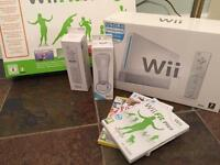 Wii white console with Wii Fit board and accessories