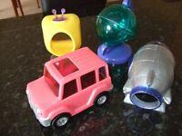 Various plastic dwarf hamster toys, including snowmen, Christmas toys.