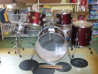 5 piece Stagg drum kit with stool, snare drum, high hat, silencer mats, drum sticks.