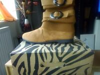 New pair of tan flat boots size 7. With box
