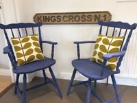 Pair of solid wooden carver chairs with Orla Kiely cushions
