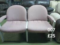 2 seater dusty pink coloured joined together leather look chairs