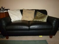 2 Seater leather effect Sofa. From Homebase. Hardly used. original packaging. Very clean and tidy.