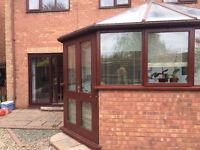 Hardwood conservatory with double glazed glass roof