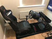 LG 43' HD smart tv with racing cockpit, gaming wheel and pedals,soundbar, PlayStation games