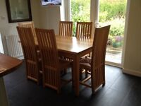 Oak extending dining table and six chairs