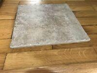 14 beige ceramic tiles. Measurements 29cm by 29cm